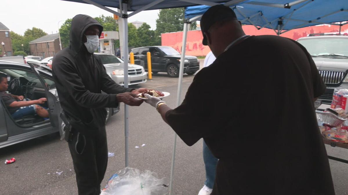 Members of One Nation Riders pass out food to residents of Louisville