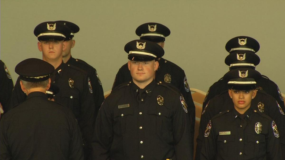 Members of LMPD's last graduating class of 2019 stand