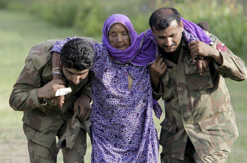 Pakistani army soldiers help elderly villager