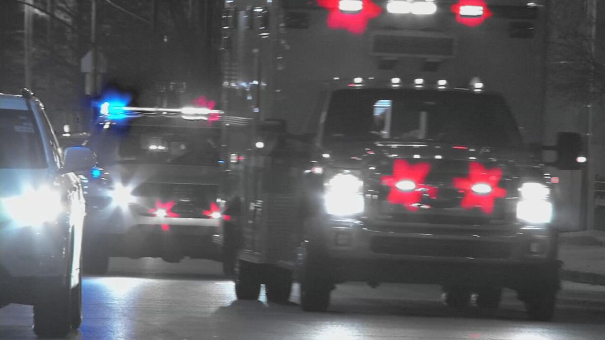 Ambulance followed by police car