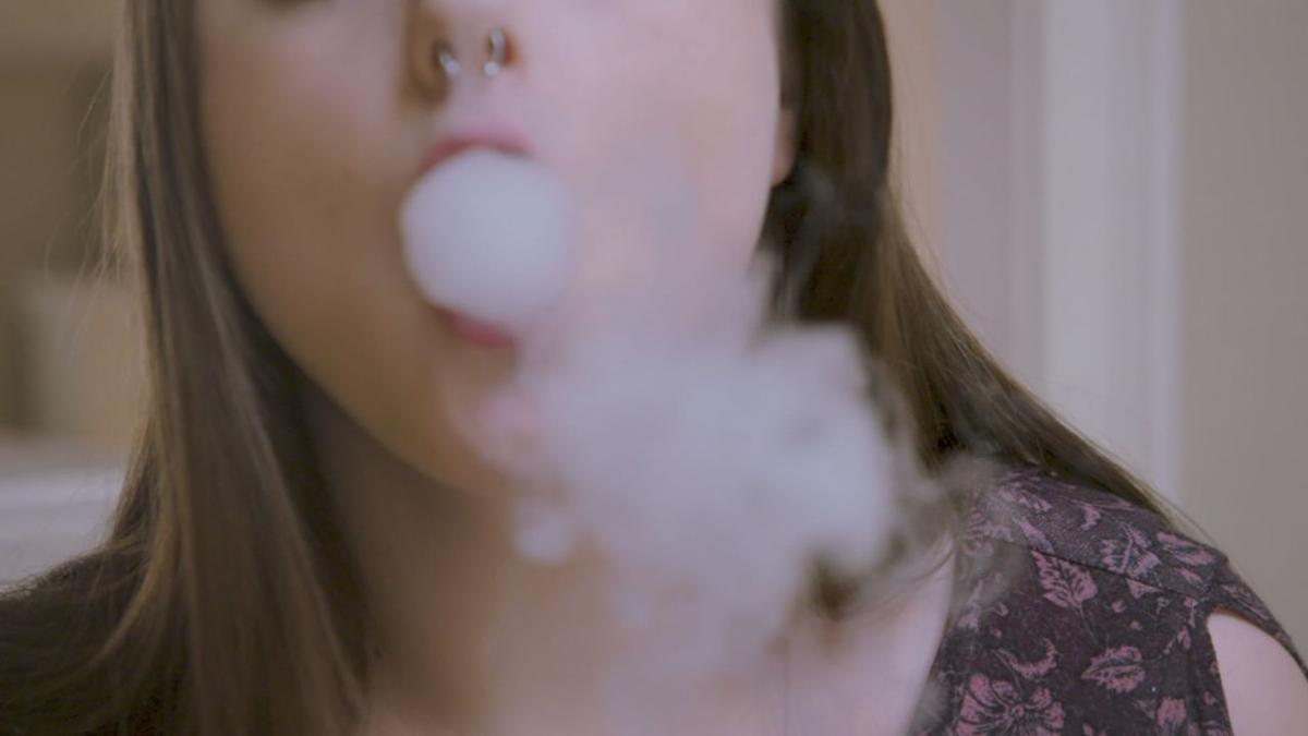 Woman vaping (generic)