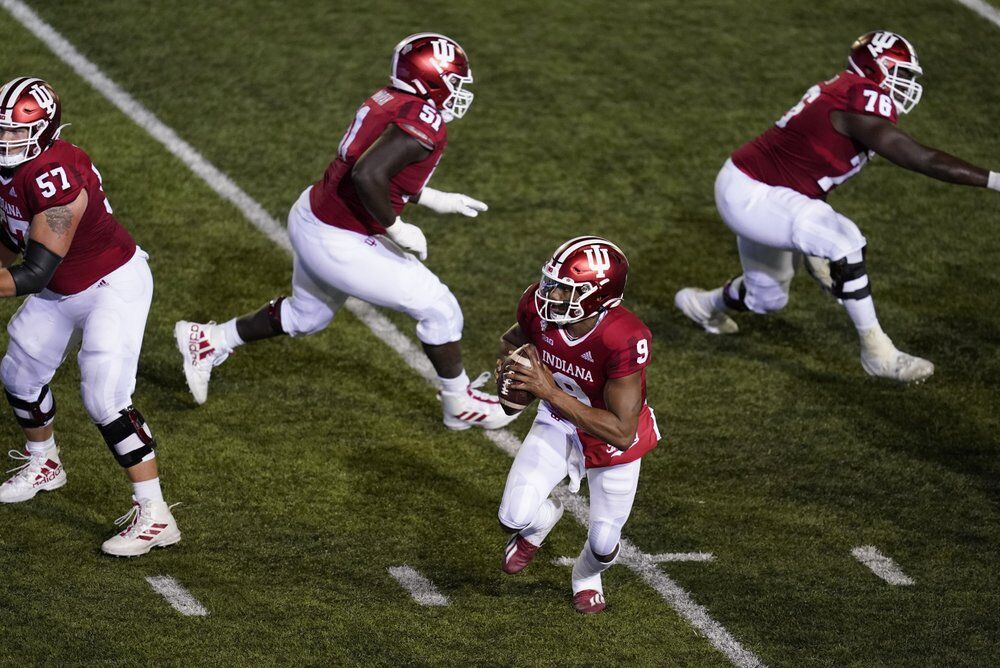 Indiana quarterback Michael Penix Jr. (9) runs in for a two-point conversion
