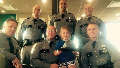Five-year-old girl buys ice cream for troopers following funeral of Joseph Ponder