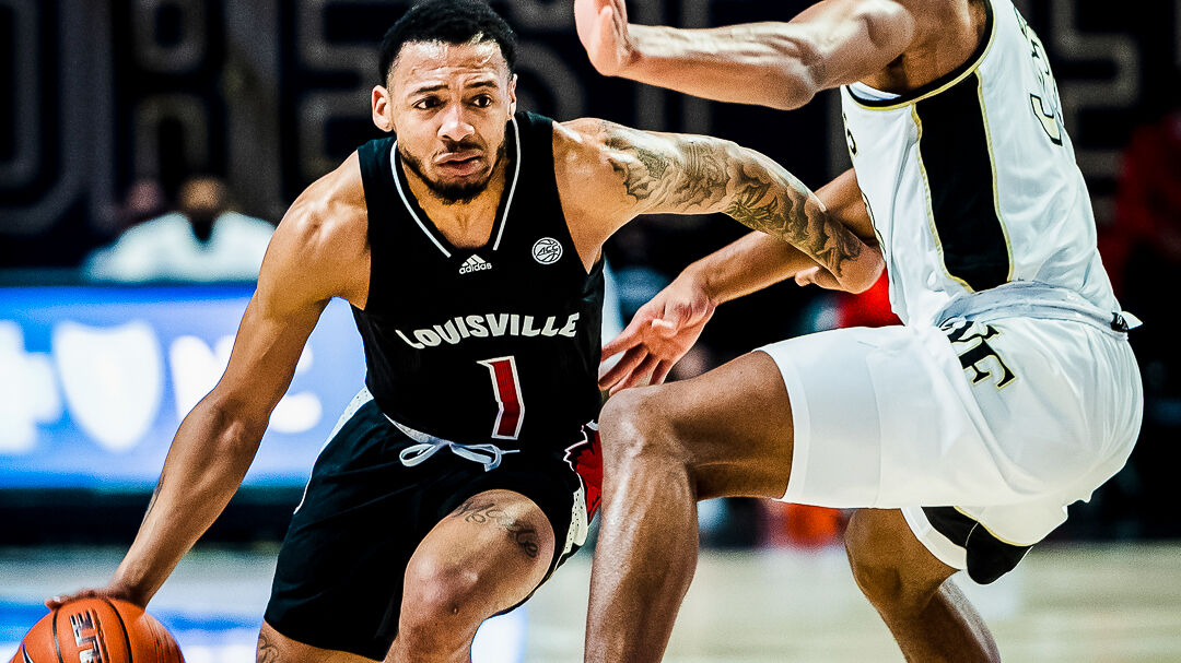 Louisville guard Carlik Jones dribbles past a Wake Forest defender