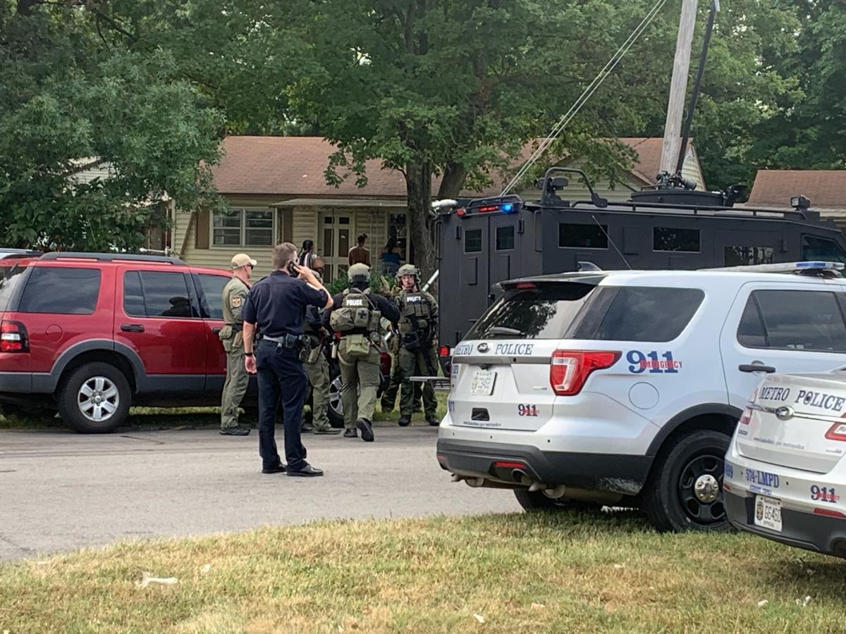 Man fires at SWAT officers during standoff in Valley Station, LMPD says