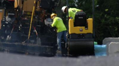 Louisville construction workers battle heat from the asphalt and the sun