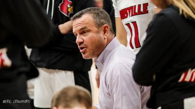 U of L head coach Jeff Walz talks to his team