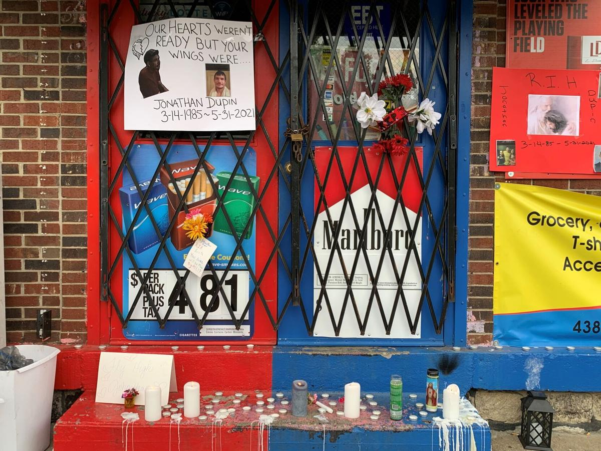 Memorials left for 36-year-old Jonathan Dupin, who was shot to death on May 31, 2021 at 2 Brothers Market on North 28th Street