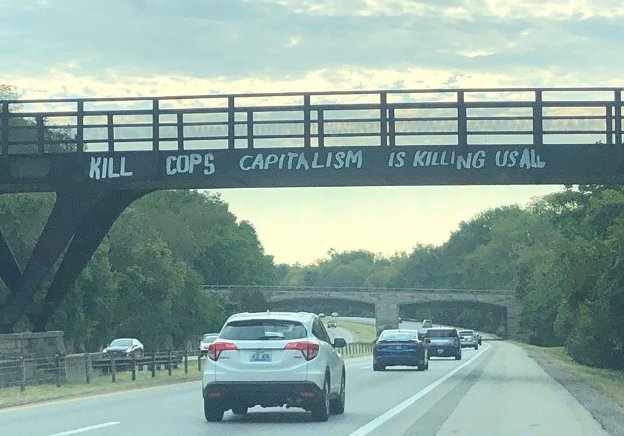 KILL COPS GRAFFITTI ON I-64 - 9-21-19 - COURTESY METRO COUNCIL DEMOCRATIC CAUCUS ON FACEBOOK.jpg