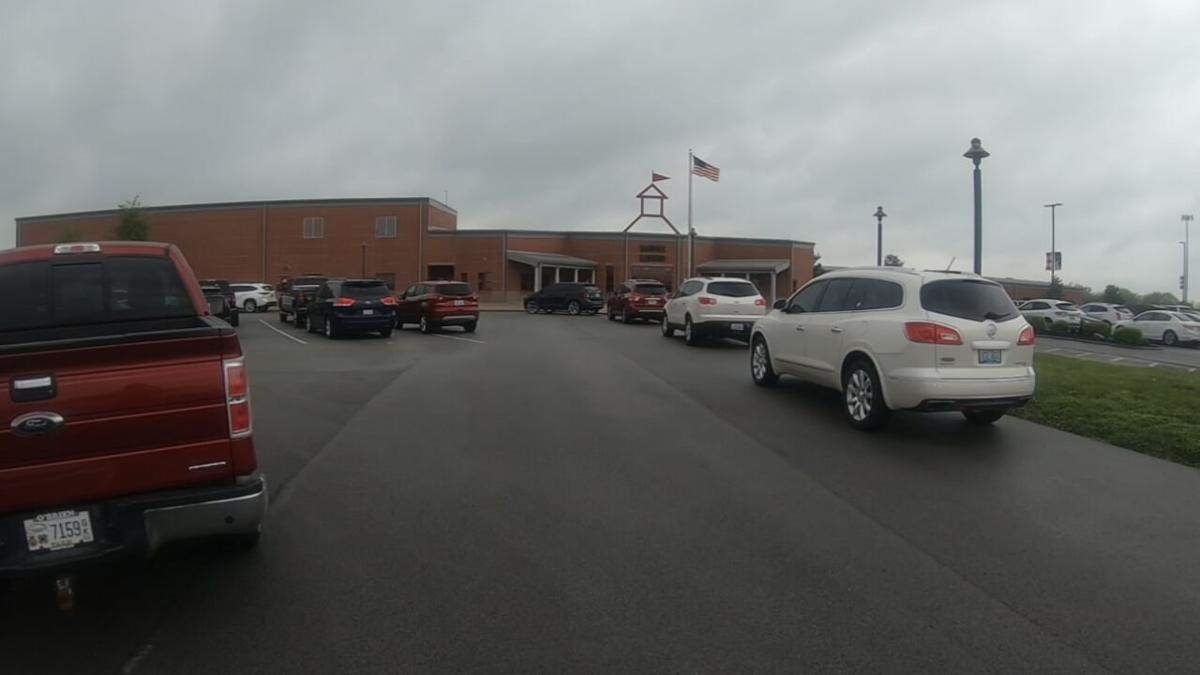 Cars parked outside Bloomfield Elementary in Bloomfield, Ky., ahead of a community meeting