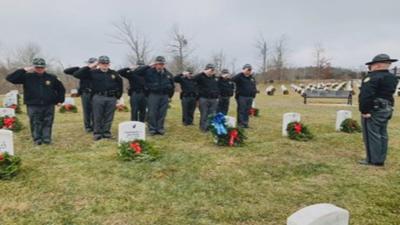 KSP Troopers Lay Wreaths on Graves