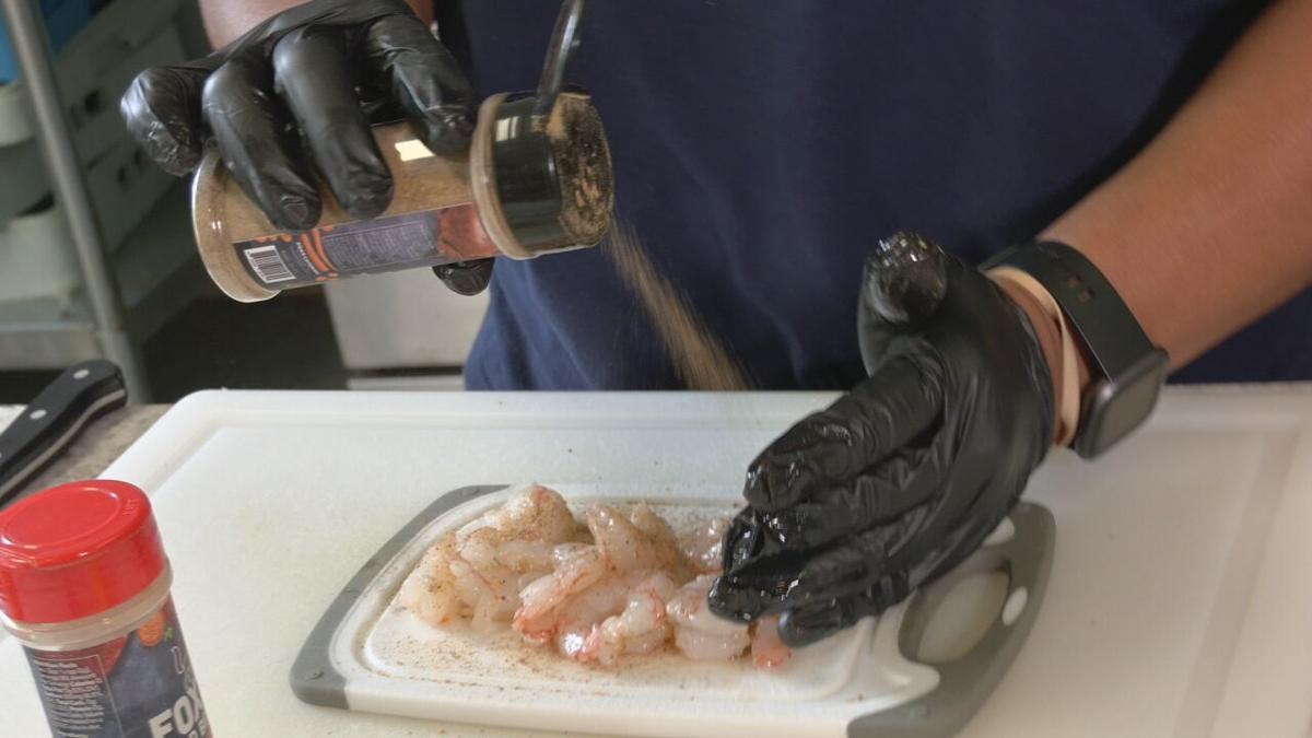 Travis Foxx uses Foxx's Fantastic Fish Rub on shrimp