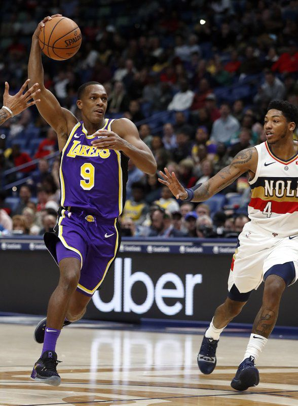 Rajon Rondo drives past New Orleans Pelicans guard Elfrid Payton