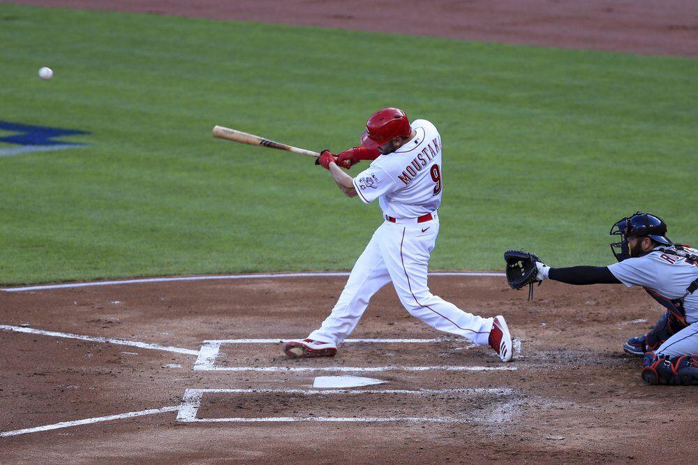 Cincinnati Reds' Mike Moustakas (9) hits an RBI-single