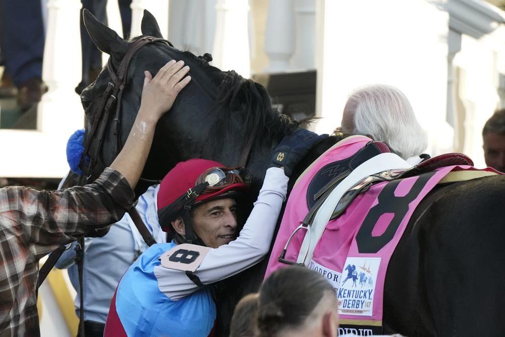 Jockey John Velazquez hugs Medina Spirit.jpeg
