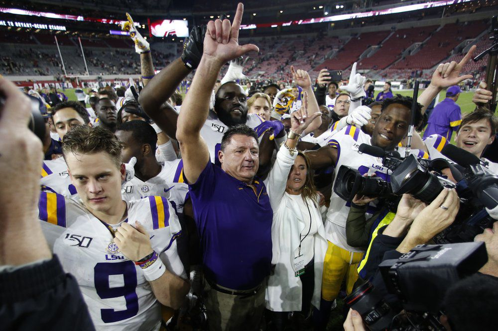 LSU head coach Ed Orgeron celebrates with his players