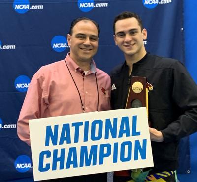Coach Arthur Albiero and Nick Albiero celebrate Nick's win in the 200 butterfly.jpg