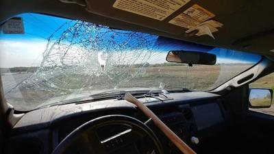 Ax smashes through windshield and strikes driver in Canada