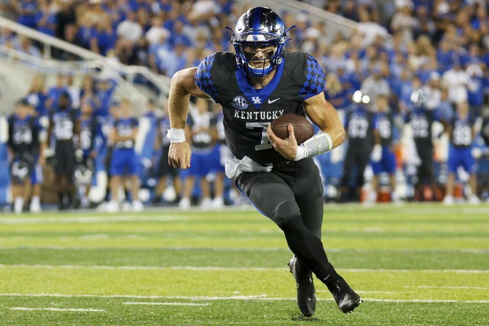 Kentucky quarterback Will Levis runs the ball against LSU