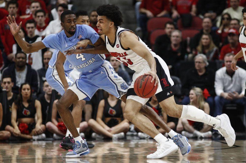 Louisville forward Jordan Nwora (33) drives to the basket