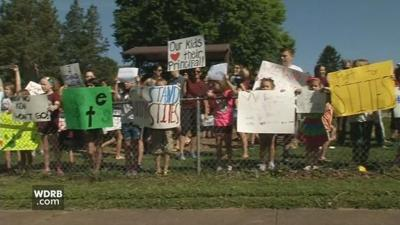 Parents and teachers rally to support dismissed JCPS elementary school principal