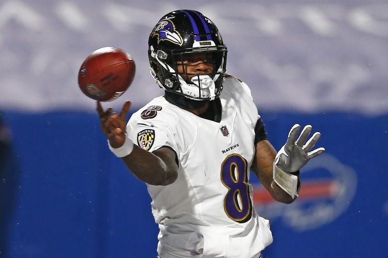Baltimore Ravens quarterback Lamar Jackson (8) throws a pass