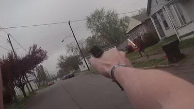 GRAPHIC: Police release gruesome body camera footage showing officers fatally shooting robbery suspect