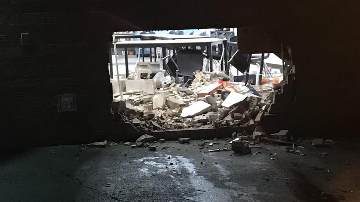 Hole in wall of Scottsburg High School after suspected DUI crash 4-28-19