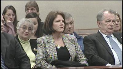 Woman accused of burning St. Matthews business returns to trial