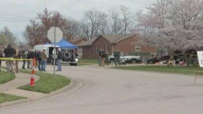 Investigators outside home of Bryan Carroll
