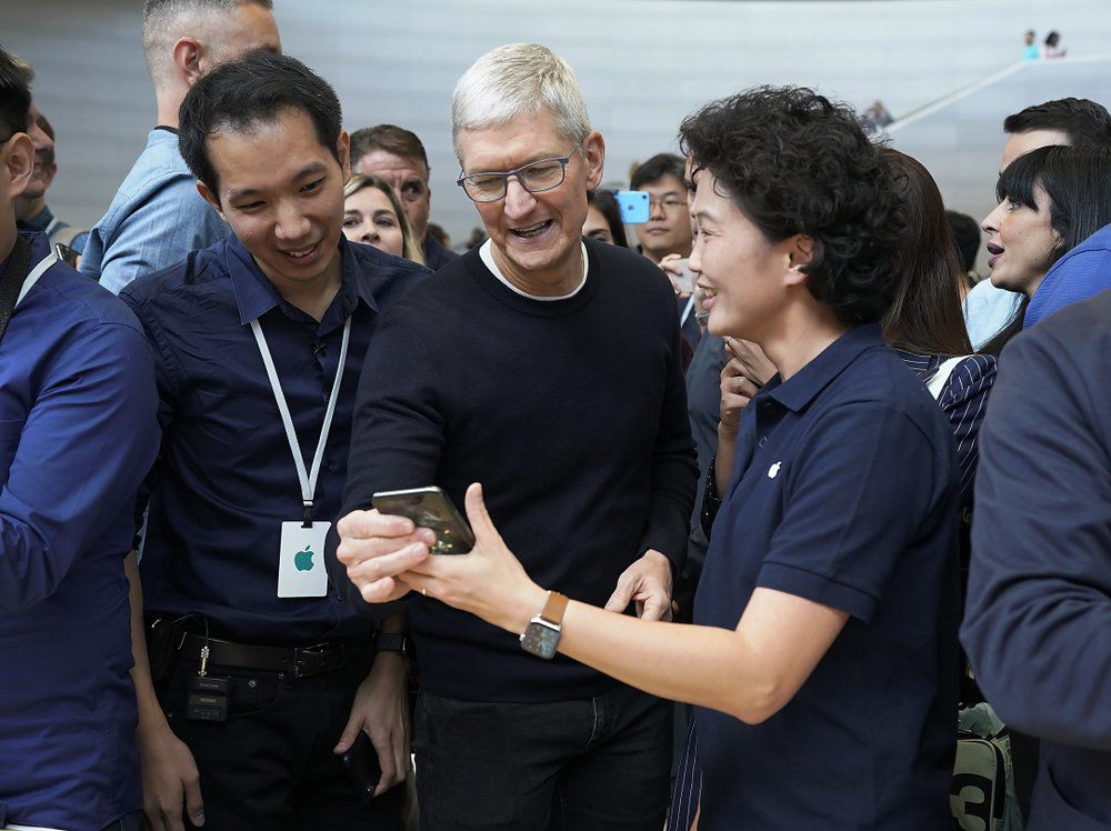 Tim Cook and new iPhone 11 Pro Max.jpeg