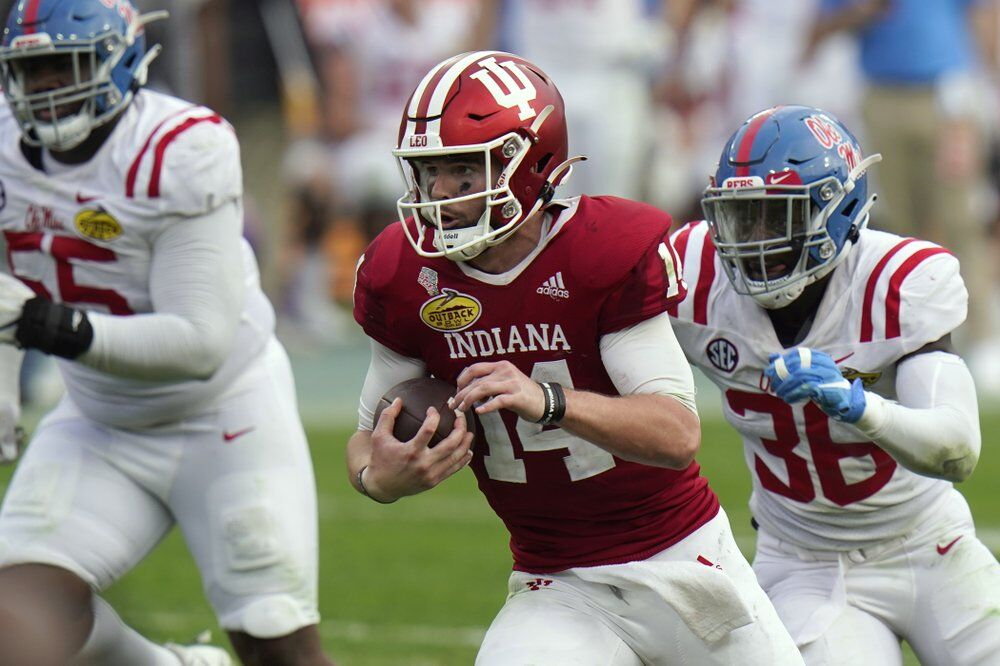 Indiana quarterback Jack Tuttle (14) runs past Mississippi linebacker Ashanti Cistrunk (36)
