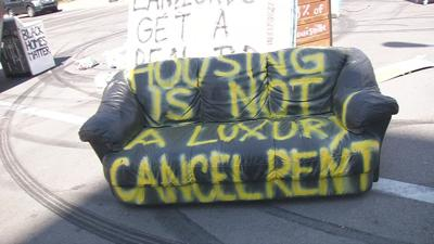 Anti-eviction protest couch in street 8-8-20