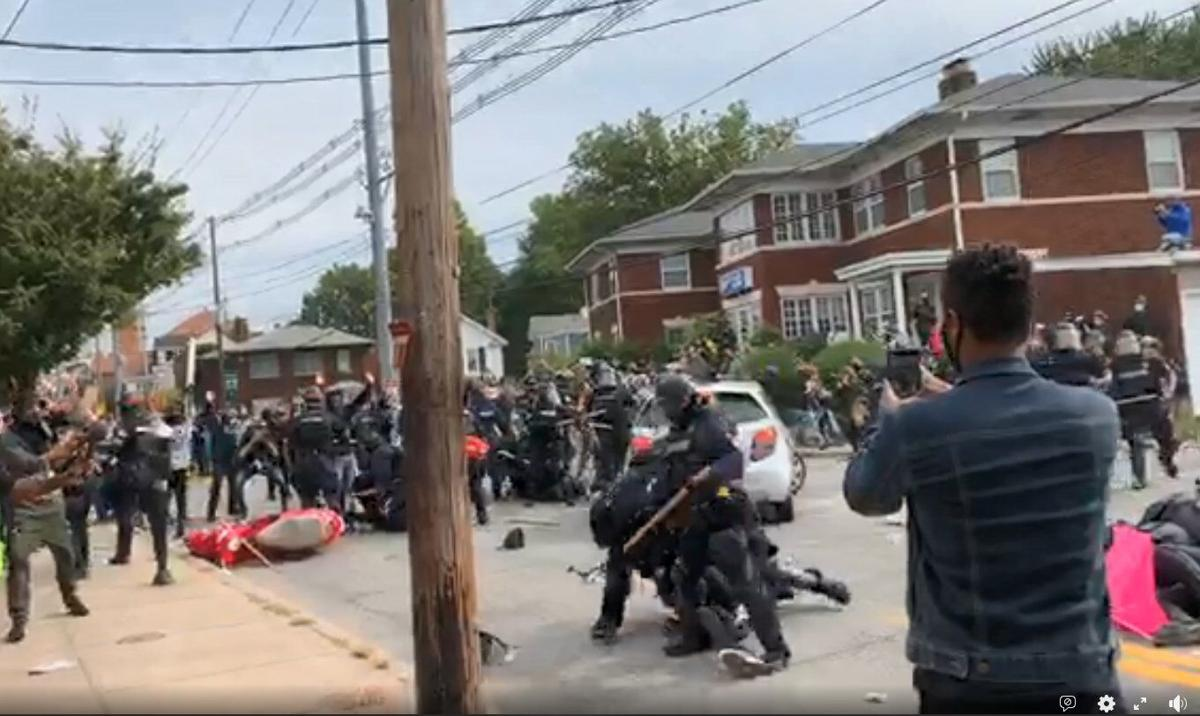 Protesters clash with police (Chris Otts Twitter)