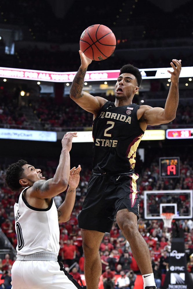 Florida State guard Anthony Polite (2) passes over the defense of Louisville guard Lamarr Kimble