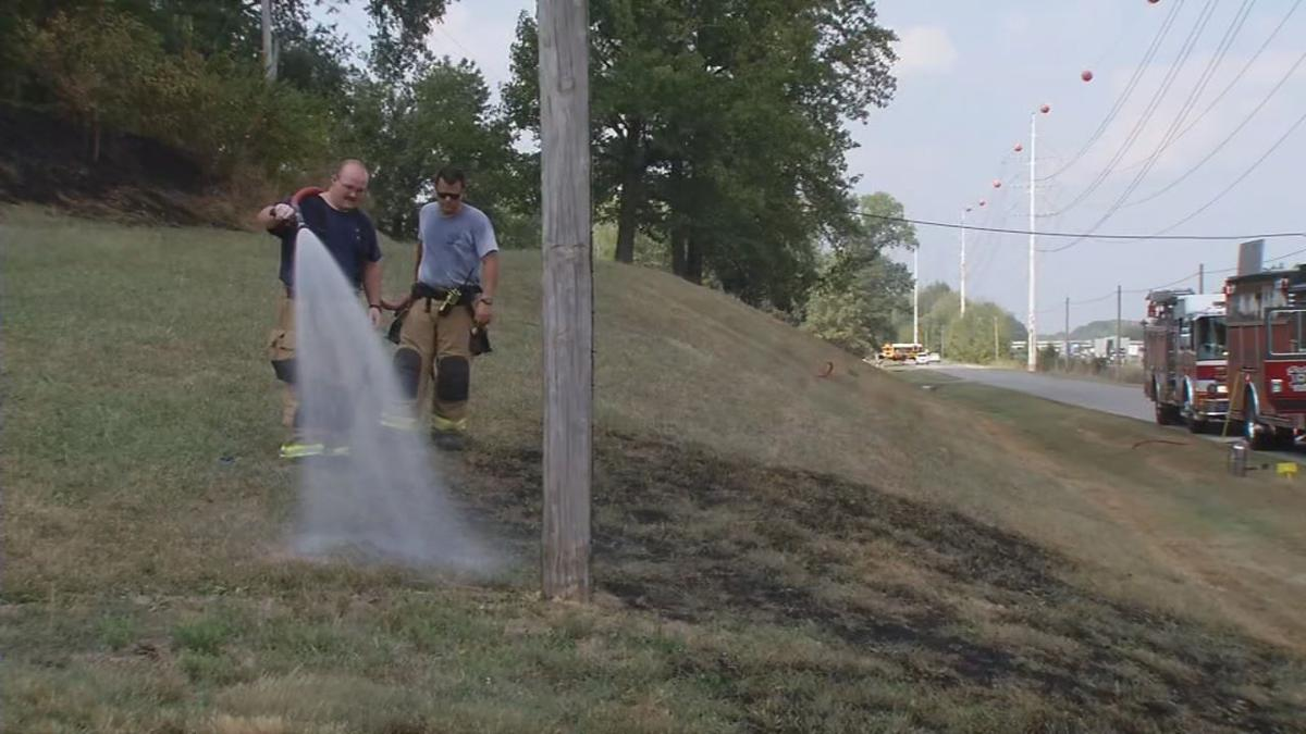 Firefighter Hosing Down Grass