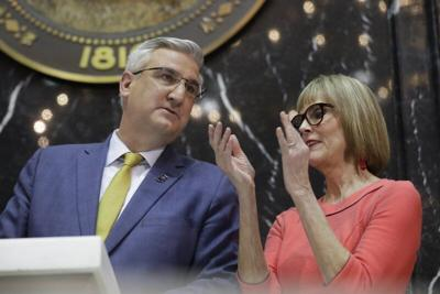 Indiana Gov. Eric Holcomb speaks with Lt. Gov. Suzanne Crouch