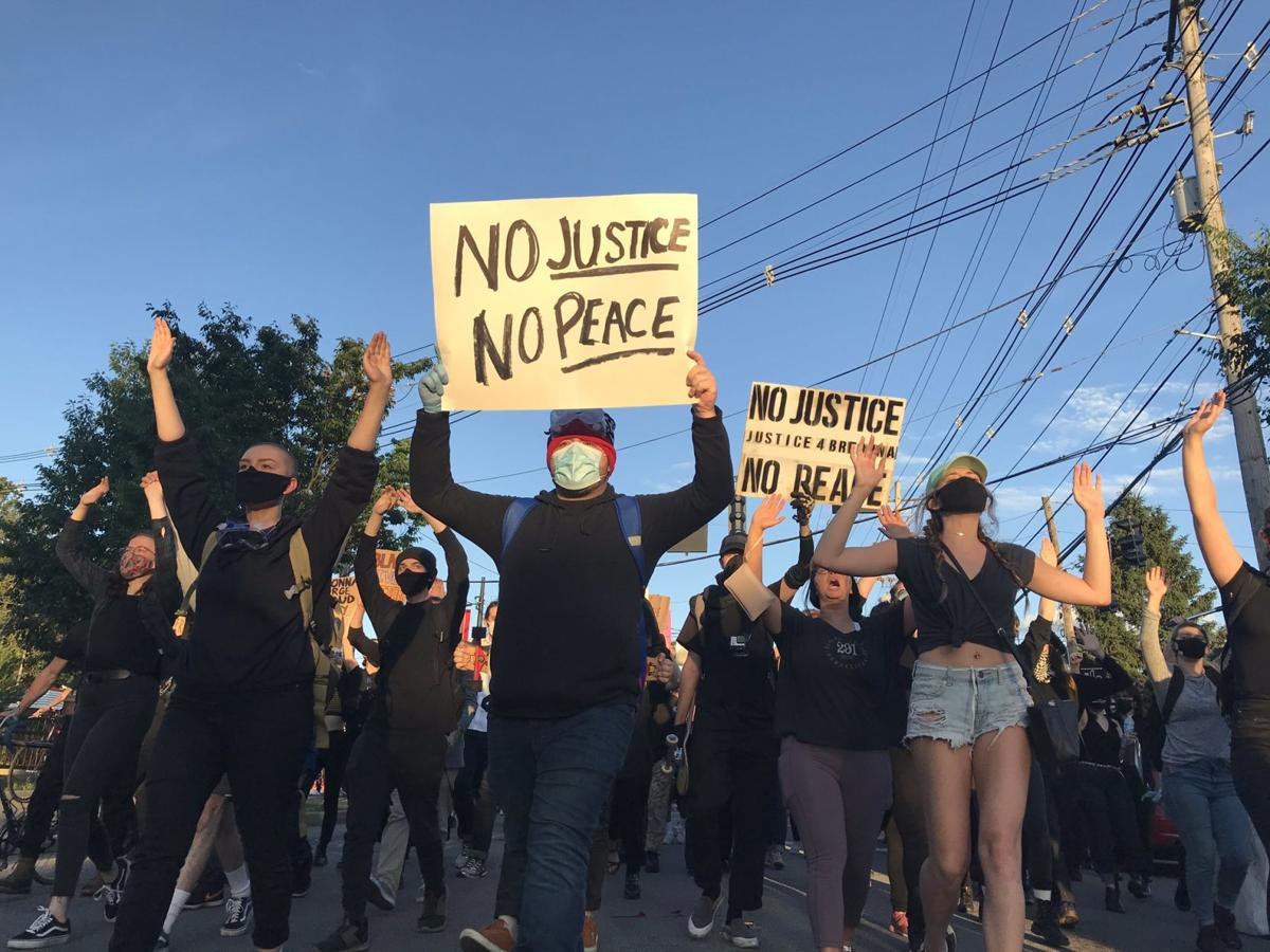 Protesters with signs, 5-30-20
