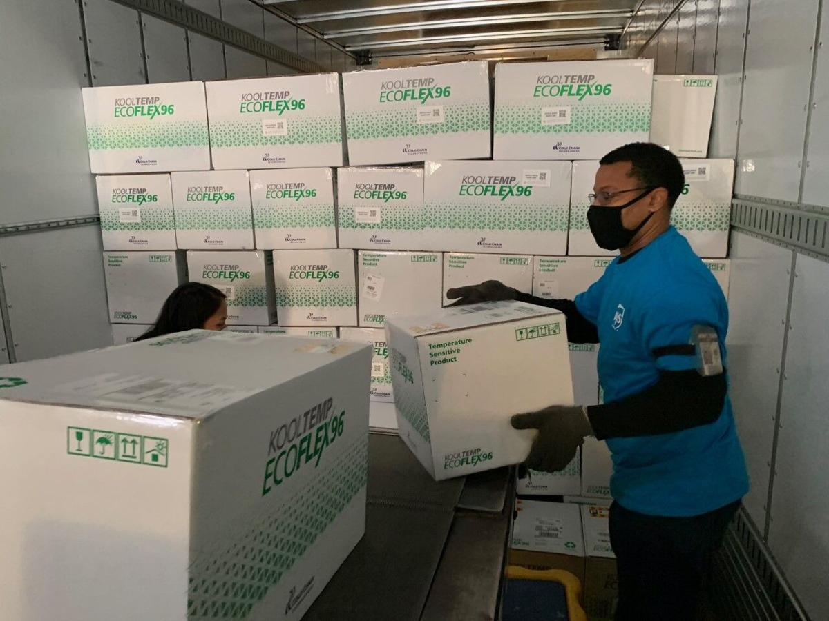 UPS workers unload shipments of the Moderna vaccine for COVID-19 (12-20-20)