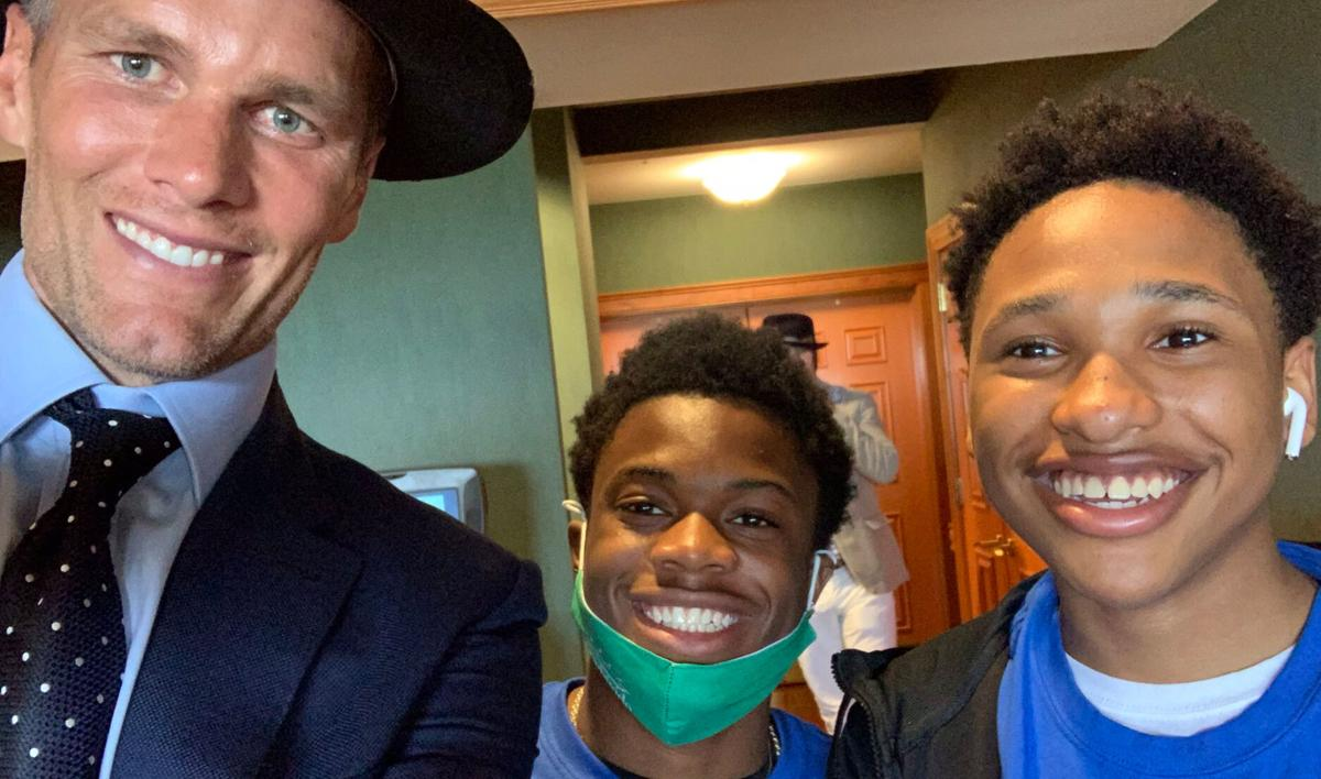 Tampa Bay quarterback Tom Brady poses with Fern Creek High School students at Kentucky Derby