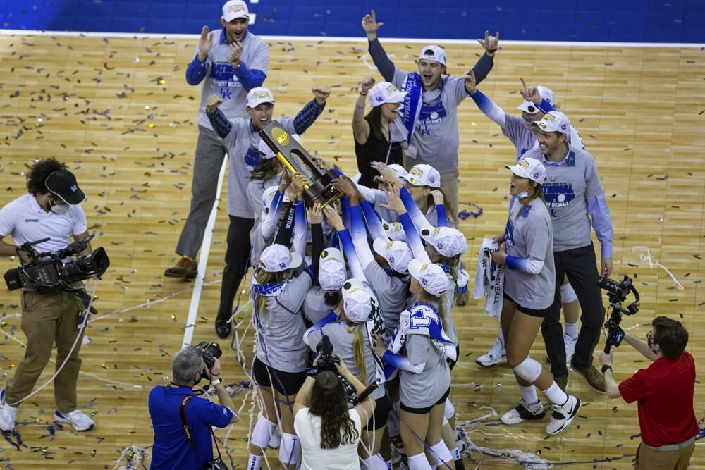 Kentucky players hold the trophy after a win against Texas in the final of the NCAA women's volleyball championships