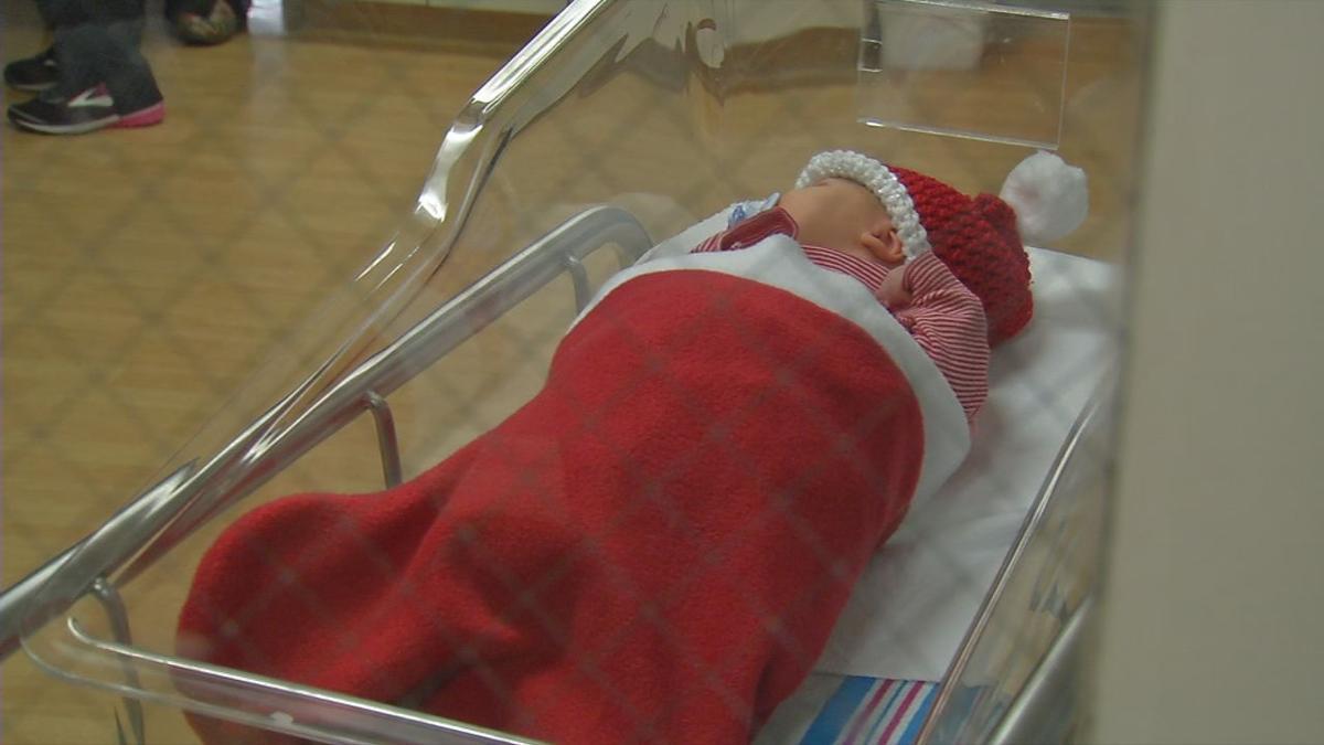 CHRISTMAS BABIES IN STOCKINGS BAPTIST HEALTH 2018 (1).jpg