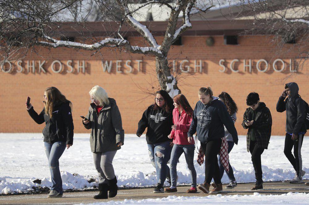 Students evacuate Oshkosh West High School in Wisconsin
