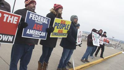 Air traffic controllers at Louisville airport rally against government shutdown