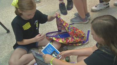 JCPS students stuff backpacks with supplies and fun for foster care kids