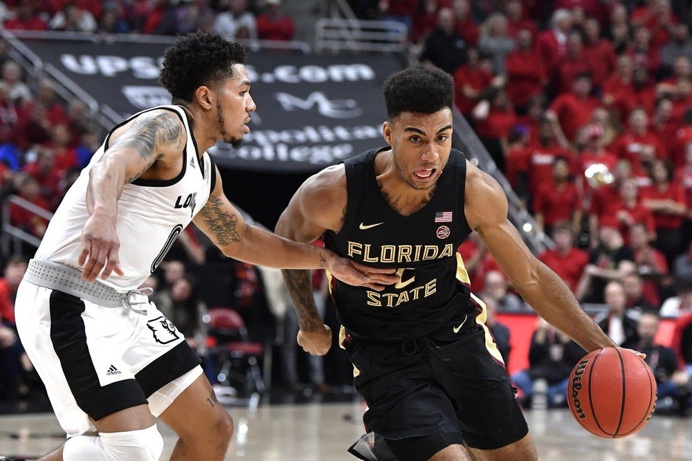 Florida State guard Anthony Polite (2) attempts to get away from the defense of Louisville guard Lamarr Kimble