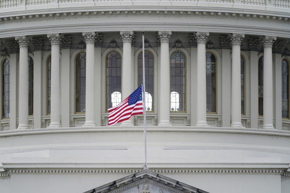 American flag half staff US capitol - AP FILE.jpeg