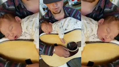 VIDEO | Aspiring country singer uses guitar to lull baby
