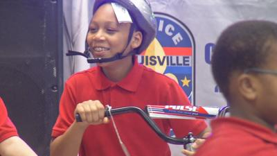 Louisville elementary students surprised with free bikes on last day of school