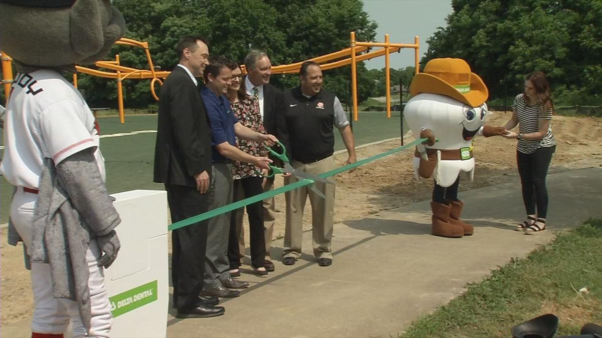 Ribbon cutting for new playground for kids with disabilities at Fern Creek Park